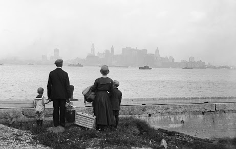 immigrants looking at the NY skyline JR
